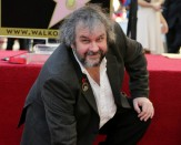 Peter Jackson poses with his Walk of Fame star