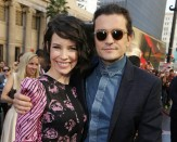 Orlando Bloom and Evangeline Lily pose for the camera